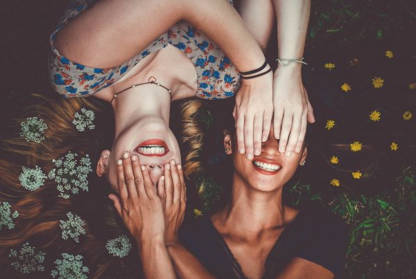 Two Girls Covering Each Others Eyes